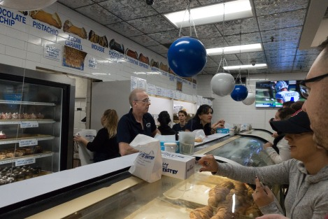 A look inside the crazy busy pastry shop near Paul Revere's House along the Freedom Trail.  Mike's pastries is a great place to grab canolis in Boston, Massacusetts