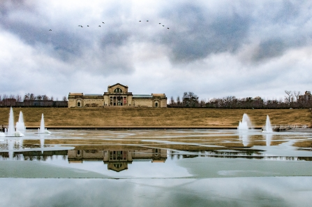 Art Hill in Forest Park in St. Louis Missouri on a frigid winter day.  The Art Museum overlooks the Grand Basin which is completely covered in ice.
