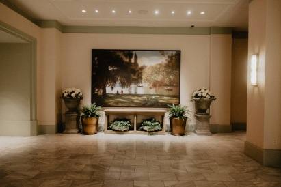 A hallway in the Park MGM Resort, filled with beautiful park inspired paintings and lots and lots of real greenery! Greetingsfromkelly. Greetings From Kelly. Kelly Blick