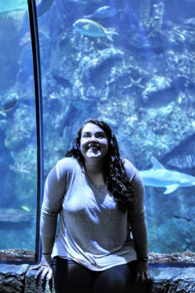 Kelly Blick in the 180-degree-view tunnel inside the aquarium at Mandalay Bay.  A shark swims by in the background.