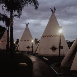 Wigwams At night at the Wigwam Village in Rialto California